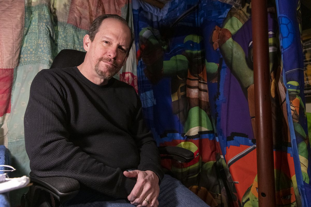 Actor and director Kevin Theis is photographed in his basement recording booth.