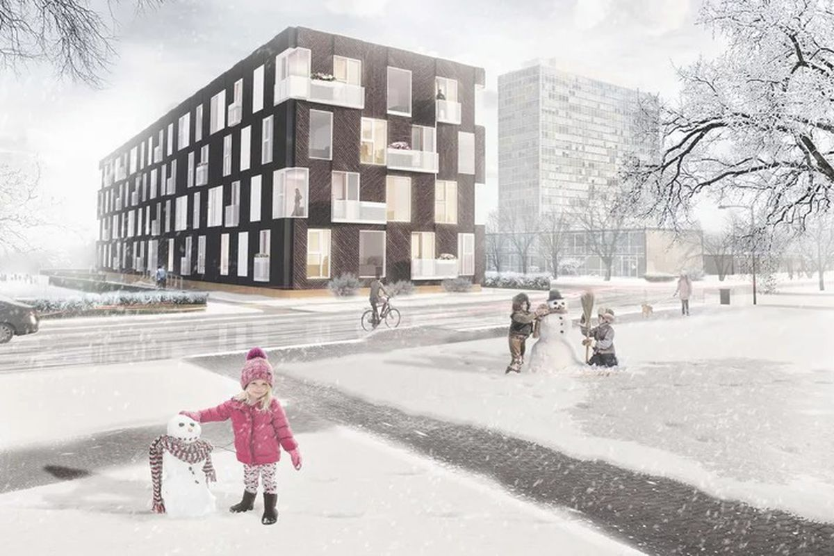 Children build snowmen outside a long, rectangular four-story building with repeating square windows and black cladding. There's snow on the ground.
