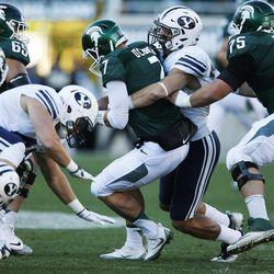 Brigham Young Cougars linebacker Sae Tautu (31) sacks Michigan State Spartans quarterback Tyler O'Connor (7)  in East Lansing, MI on Saturday, Oct. 8, 2016. BYU won 31-14.