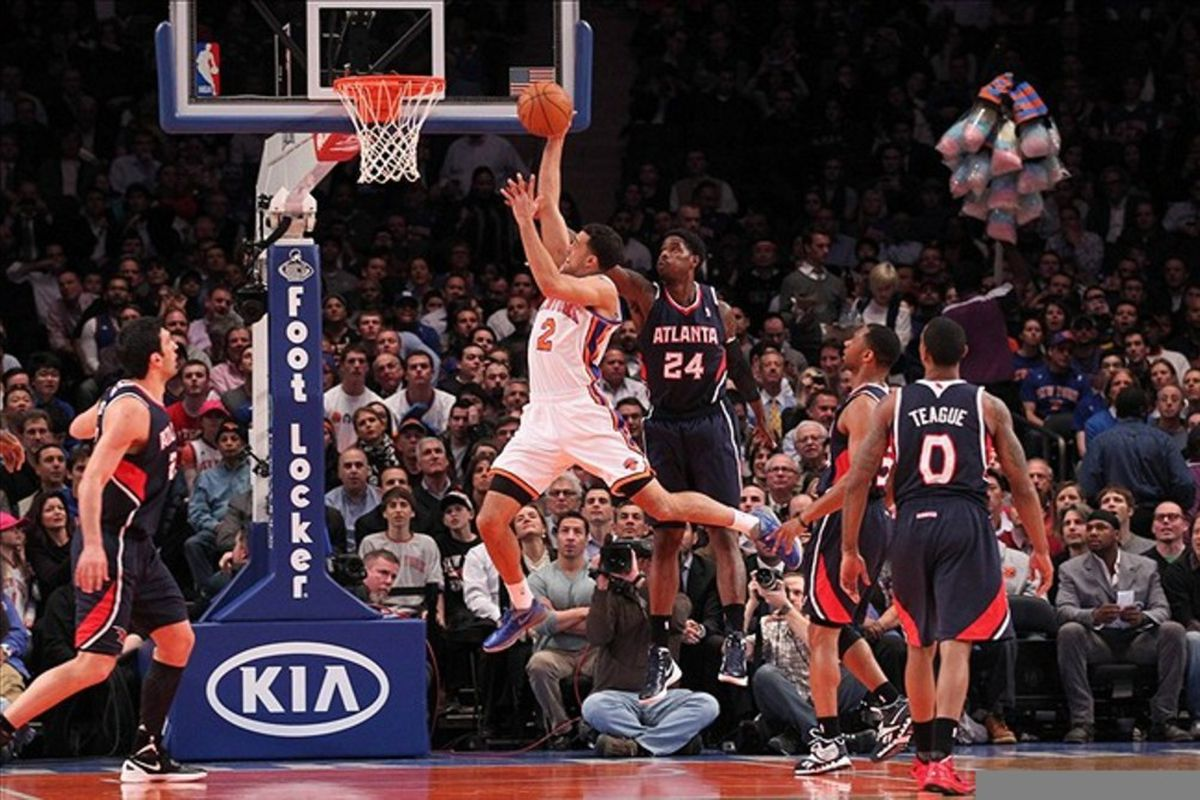 Feb 22, 2012; New York, NY, USA;  New York Knicks guard Landry Fields (2) scores against Atlanta Hawks small forward Marvin Williams (24) during the first quarter at Madison Square Garden.  Mandatory Credit: Anthony Gruppuso-US PRESSWIRE