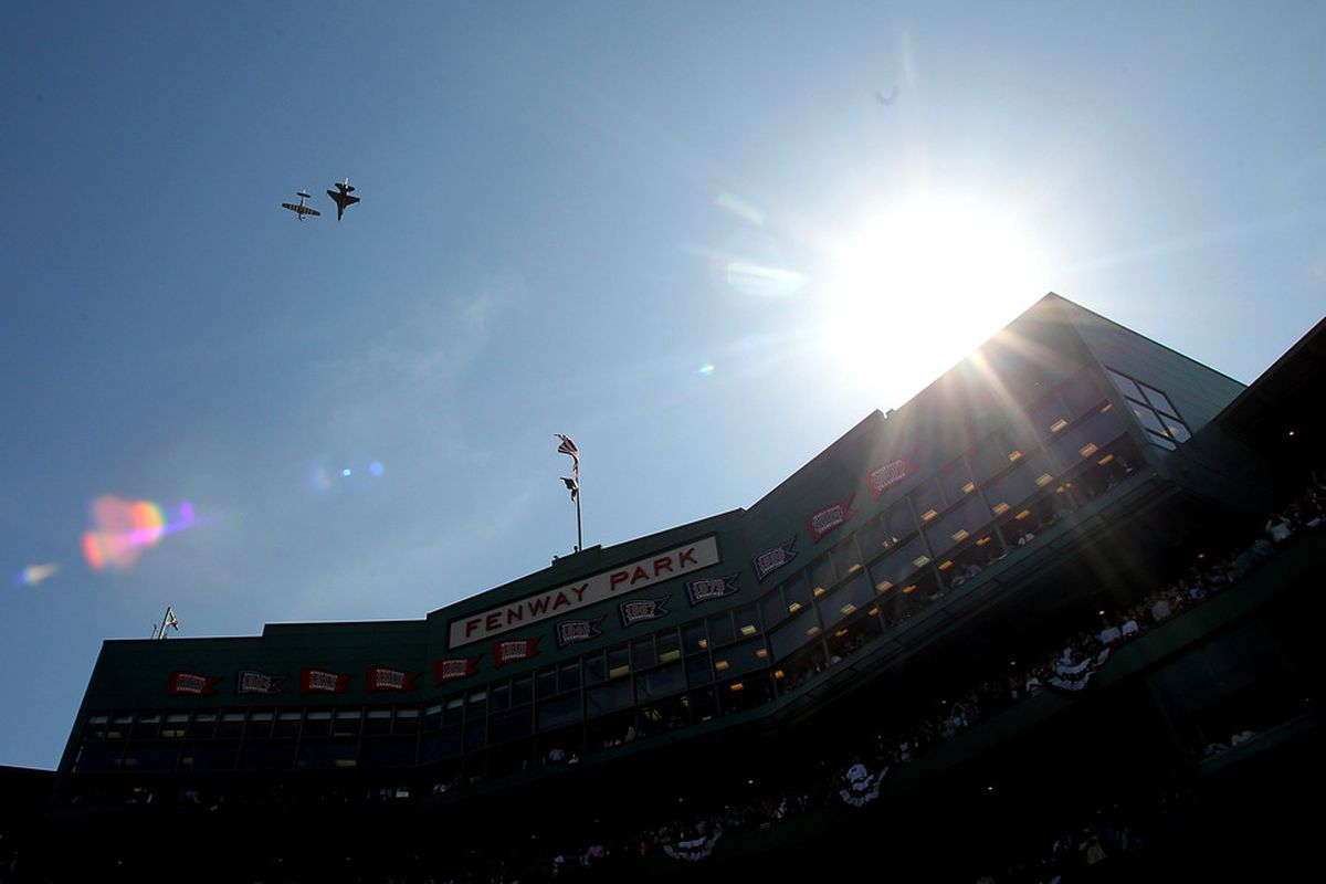 BOSTON, MA - APRIL 20:  Planes fly over Fenway Park during 100 Years of Fenway Park ceremony before a game between the Boston Red Sox and the New York Yankees at Fenway Park April 20, 2012  in Boston, Massachusetts. (Photo by Jim Rogash/Getty Images)
