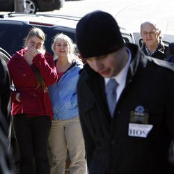 Louisa and Emily Hopkins, at back center, and Rick Hopkins at right back, watch as their brother and son, Elder Ammon Hopkins leaves them to enter the Provo Missionary Training Center of The Church of Jesus Christ of Latter-day Saints in Provo, Utah, Wednesday, Feb. 2, 2011.