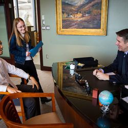Utah Valley University President Matthew S. Holland works in his office with staff members, Kyle Reyes, special assistant to the president for inclusion, left, and Kathryn Zabriskie, assistant to the chief of staff and board of trustees, in his office on the UVU campus in Orem on Wednesday March 15, 2017.
