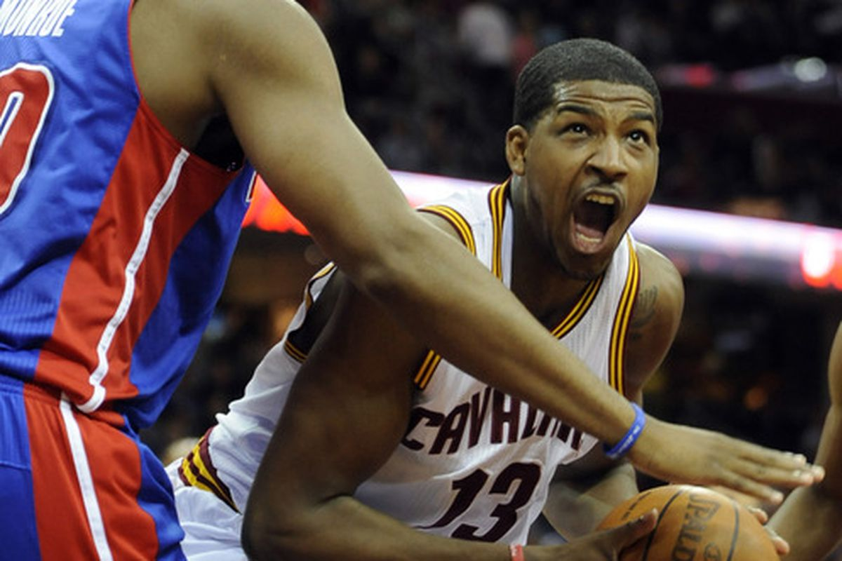 Mar 28, 2012; Cleveland, OH, USA; Cleveland Cavaliers forward Tristan Thompson (13) looks to shoot against Detroit Pistons center Greg Monroe (10) in the second quarter at Quicken Loans Arena. Mandatory Credit: David Richard-US PRESSWIRE