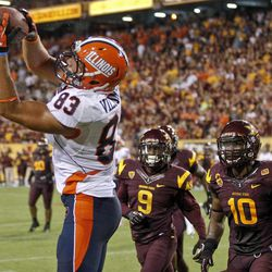 Illinois tight end Eddie Viliunas (83) pulls in a touchdown pass as Arizona State's Robert Wilson (9) and Keelan Johnson (10) defend during the second half of an NCAA college football game, Saturday, Sept. 8, 2012,in Tempe, Ariz.