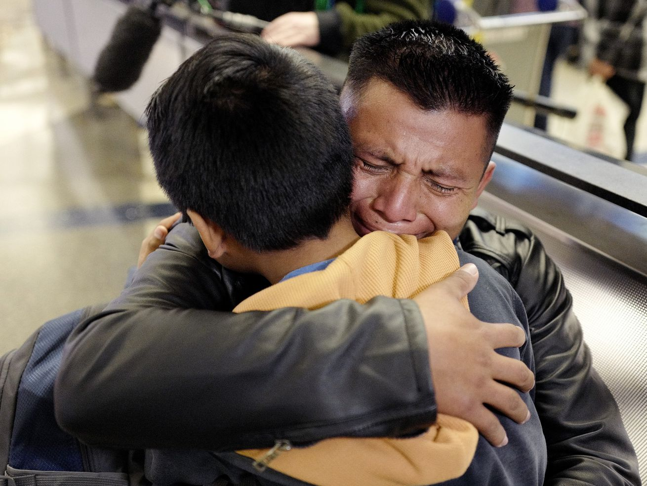 In this Wednesday, Jan. 22, 2020, file photo, David Xol-Cholom, of Guatemala, hugs his son Byron at Los Angeles International Airport as they reunite after being separated during the Trump administration's wide-scale separation of immigrant families, in Los Angeles.