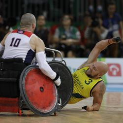 Australia's Ryley Batt, right, reacts as he is tackled by United States' Josh Wheeler at the end of the mixed wheelchair rugby final match at the Paralympic Games in Rio de Janeiro, Brazil, Sunday, Sept. 18, 2016. Australia won the gold medal.
