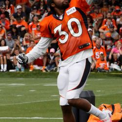 Broncos safety David Bruton practices making grabs with tennis balls before day 4 of training camp begins.