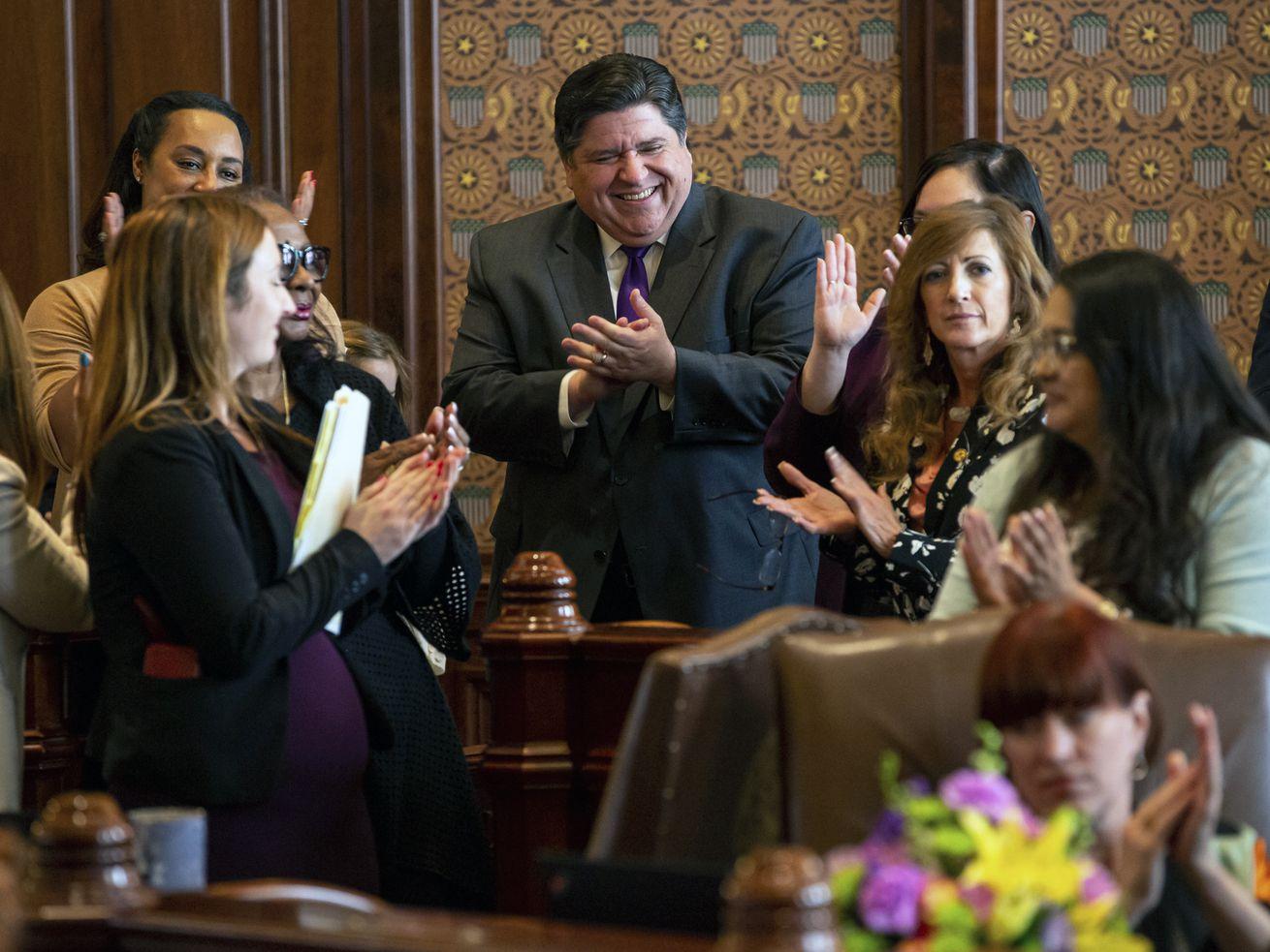Gov. J.B. Pritzker cheers as Illinois Senate President John Cullerton, D-Chicago, gives his final remarks on the floor of the Illinois Senate on Sunday.