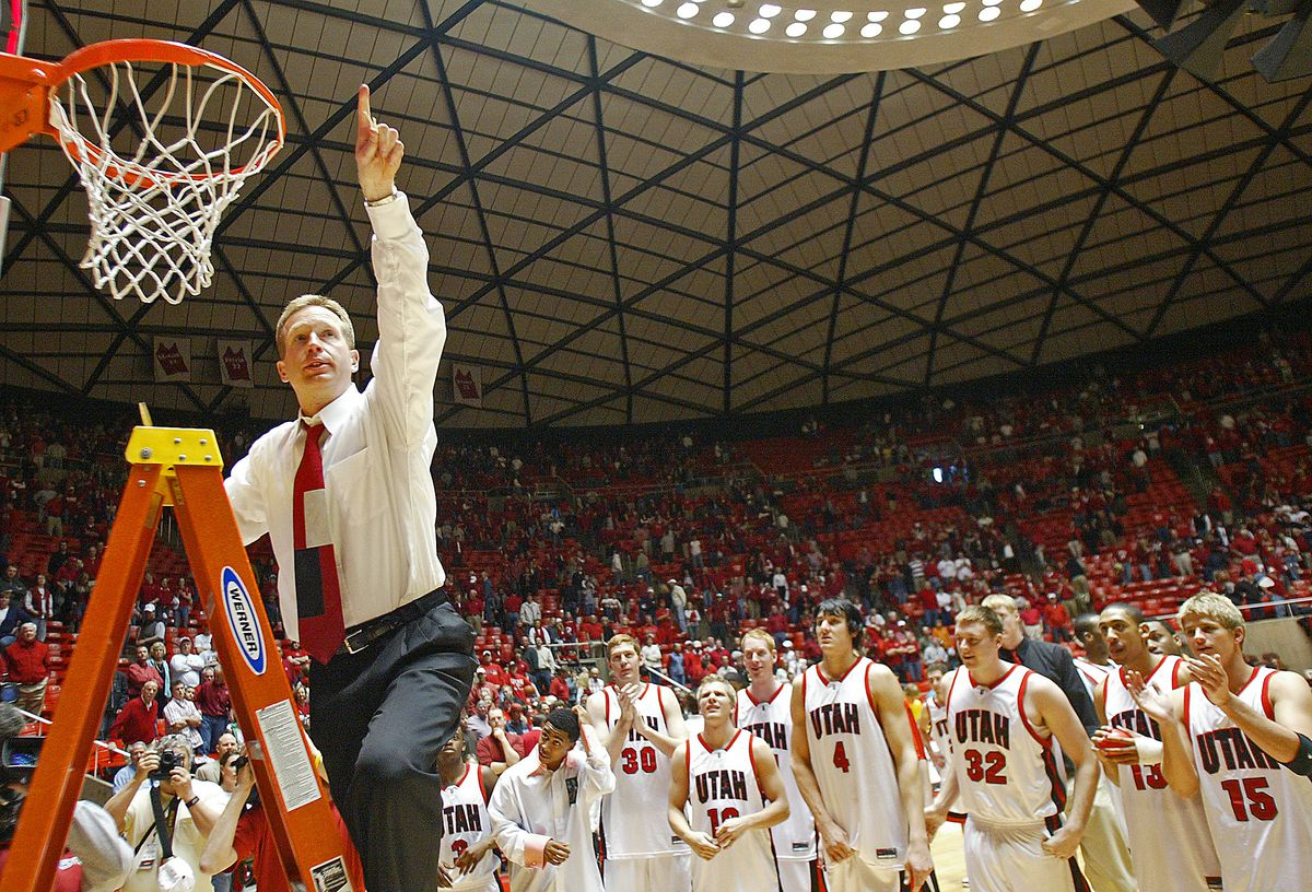 20150901 Utah's coach Ray Giacoletti celebrates after cutting off a piece of the net after his team won the Mountain West Conference with a 69-60 win over BYU at the Huntsman Center Saturday, Feb. 26, 2005. August Miller/ Deseret Morning News DIGITAL PHOTOGRAPH (Submission date: 02/26/2005) August Miller August Miller/Deseret Morning Ne August Miller/ Deseret Morning News DIGITAL PHOTOGRAPH