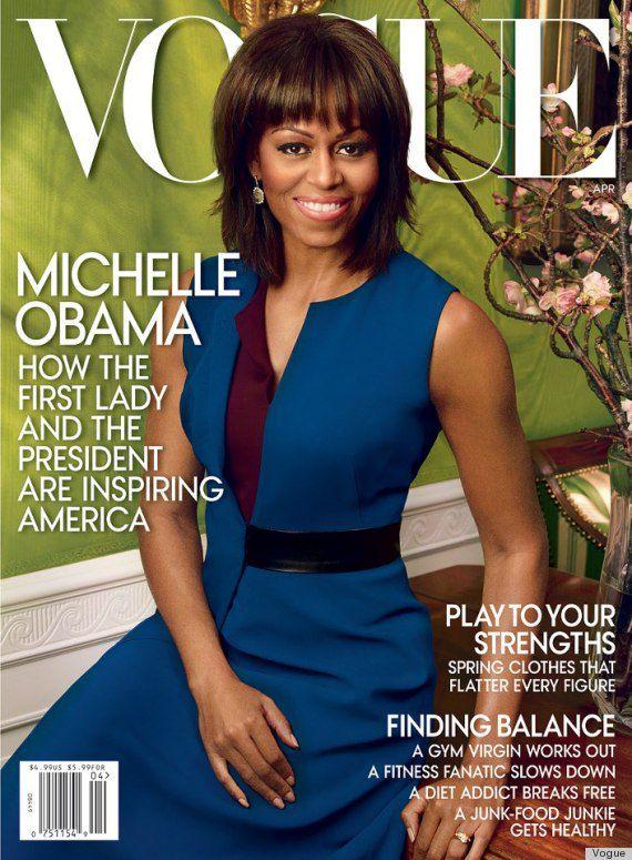 Michelle Obama wears a blue sheath dress.