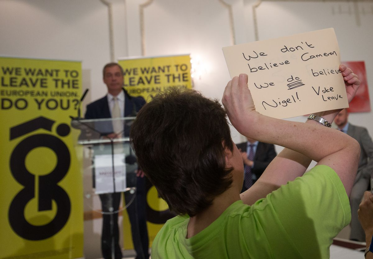 """Person at Leave rally with sign that says """"We don't believe Cameron"""""""