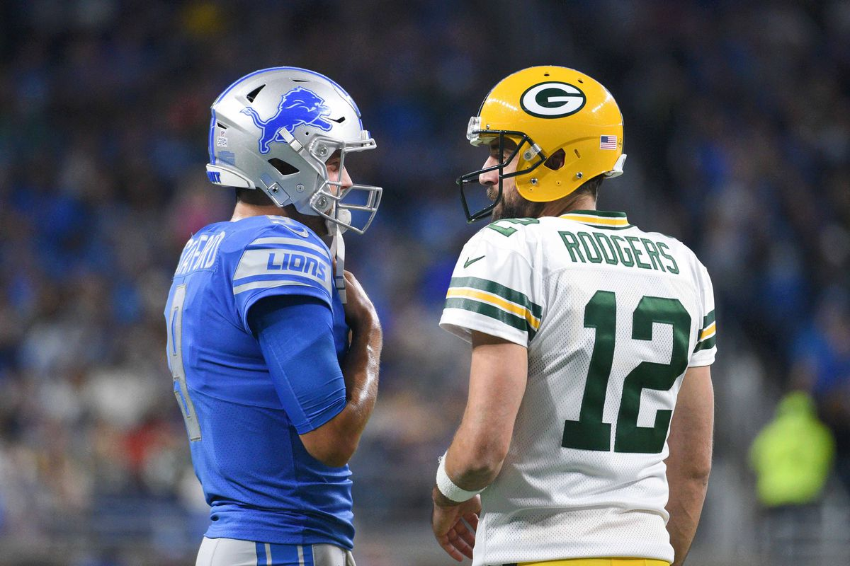 Detroit Lions quarterback Matthew Stafford and Green Bay Packers quarterback Aaron Rodgers chat during the first quarter at Ford Field.
