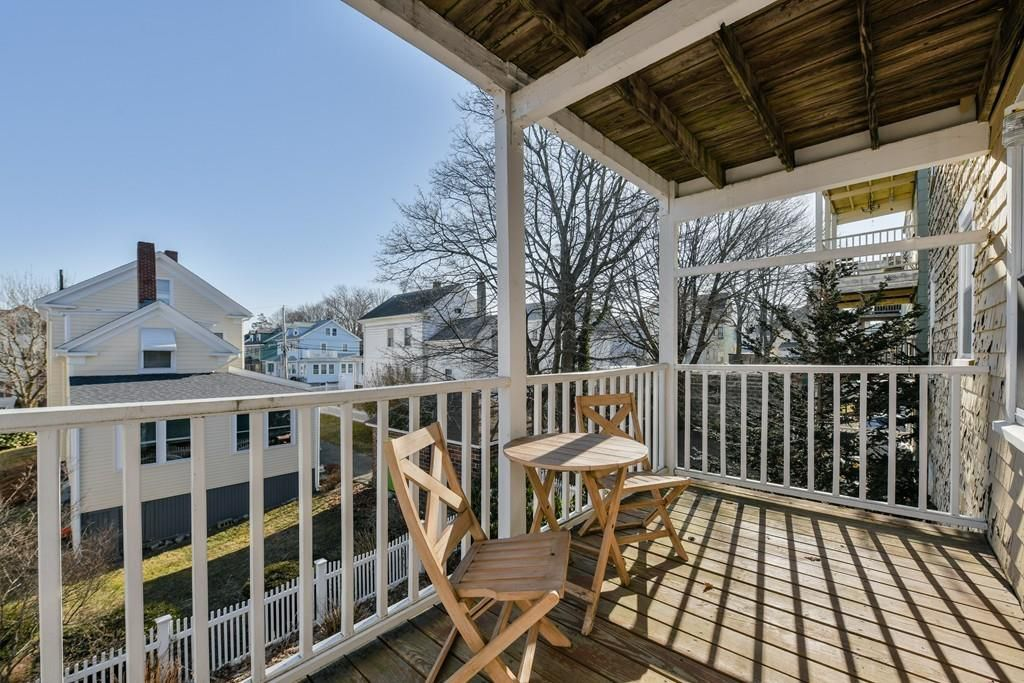 A back deck with a table and chairs.