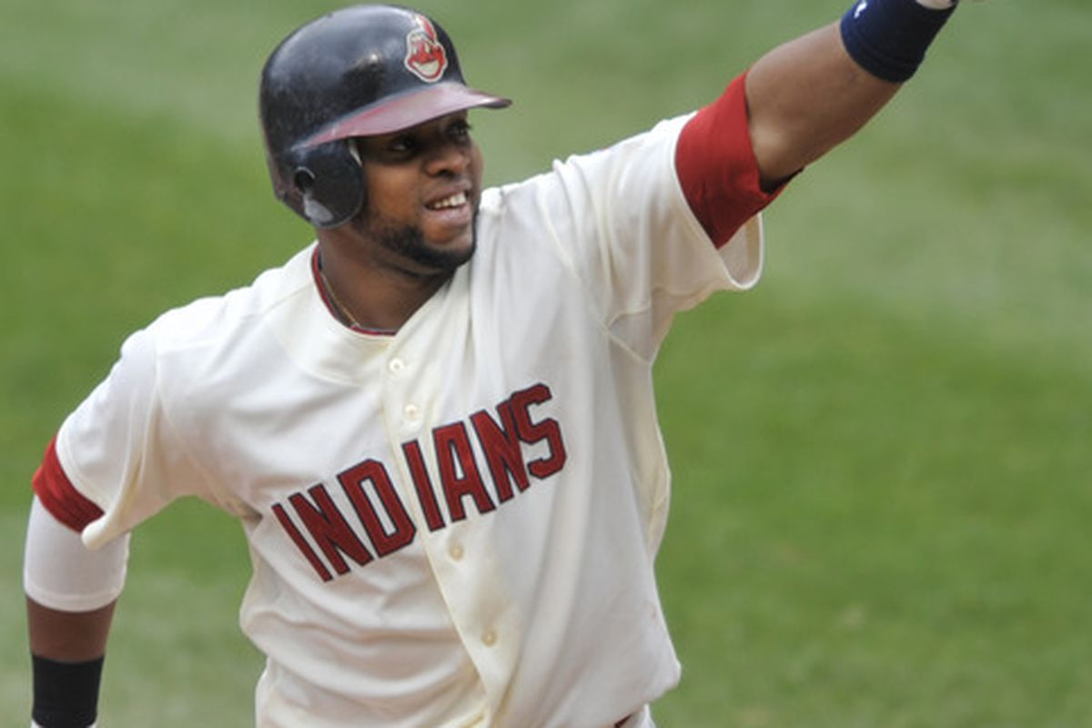 Apr 8, 2012; Cleveland, OH, USA; Cleveland Indians catcher Carlos Santana (41) celebrates a solo home run in the second inning against the Toronto Blue Jays at Progressive Field. Mandatory Credit: David Richard-US PRESSWIRE