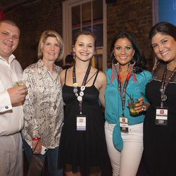 Ann Tuennerman, founder of Tales of the Cocktail, poses alongside her staff members for a photograph Friday evening.   These are the people who make all this possible!