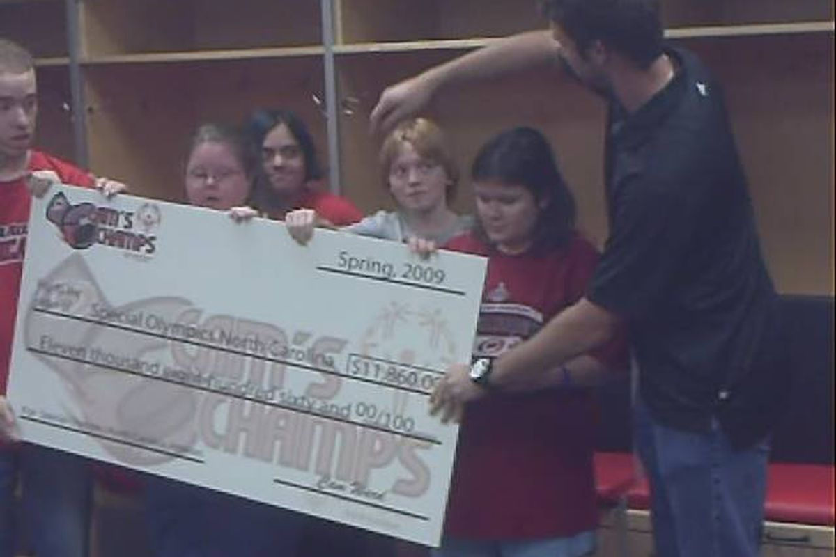 """Cam Ward with """"Cam's Champs"""" and BIG check."""