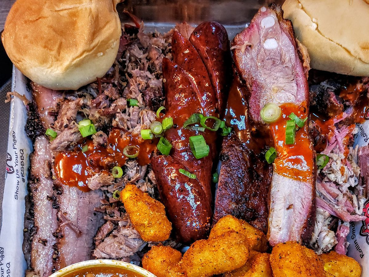 Brisket, tater tots, beans, mac and cheese, and a biscuit