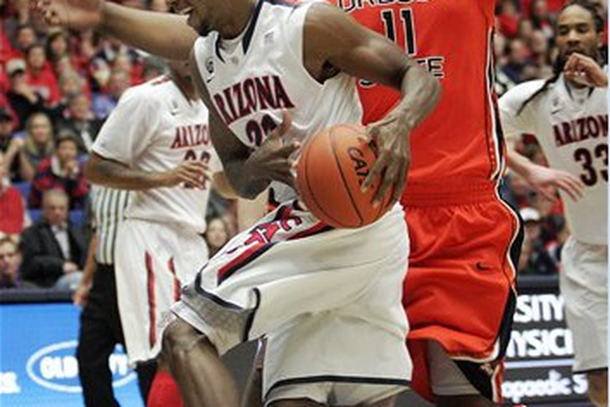 Joe Burton will not face further sanctions from the Pac-12 as a result of the brawl that Kyle Fogg, above driving past Burton, instigated. <em>(AP Photo by John Miller)</em>