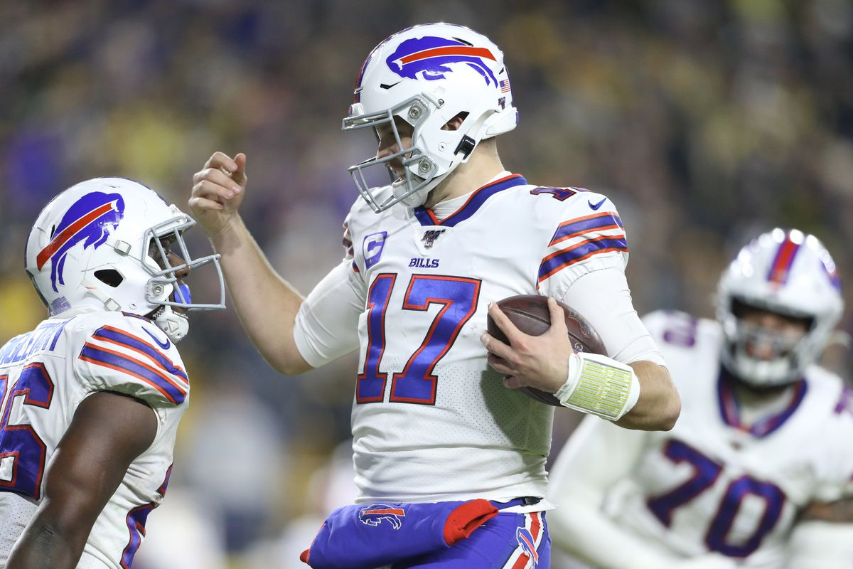 Buffalo Bills quarterback Josh Allen celebrates his touchdown with running back Devin Singletary against the Pittsburgh Steelers during the second quarter at Heinz Field.