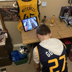 Jazz fan Talmage Howlett places his head on his desk at home in boredom during the break in play caused by the coronavirus crisis.