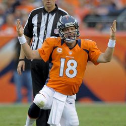 Denver Broncos quarterback Peyton Manning (18) reacts after a sack in the fourth quarter of an NFL football game against the Houston Texans, Sunday, Sept. 23, 2012, in Denver.