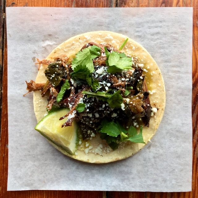 A top-dpwn image of the brisket taco at Standard Brewing.