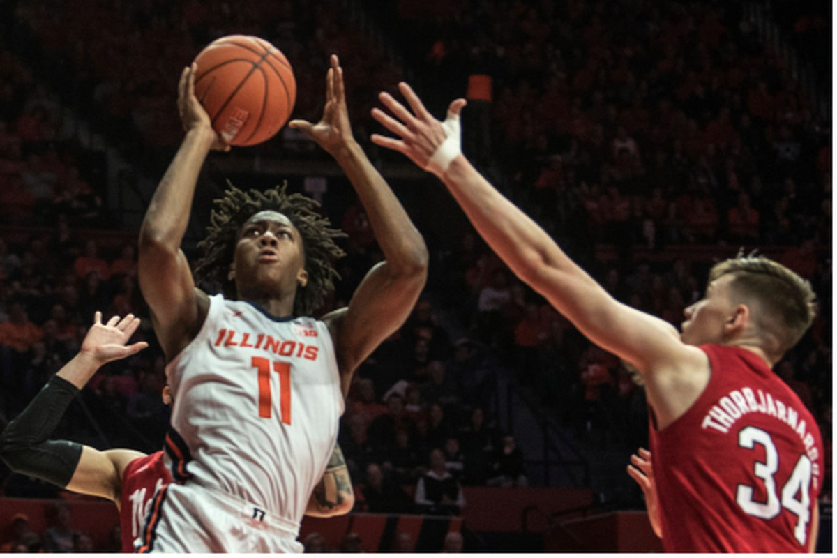 Illinois' Ayo Dosunmu goes up for a shot against Nebraska's Thorir Thorbjarnarson in the first half Monday in Champaign.