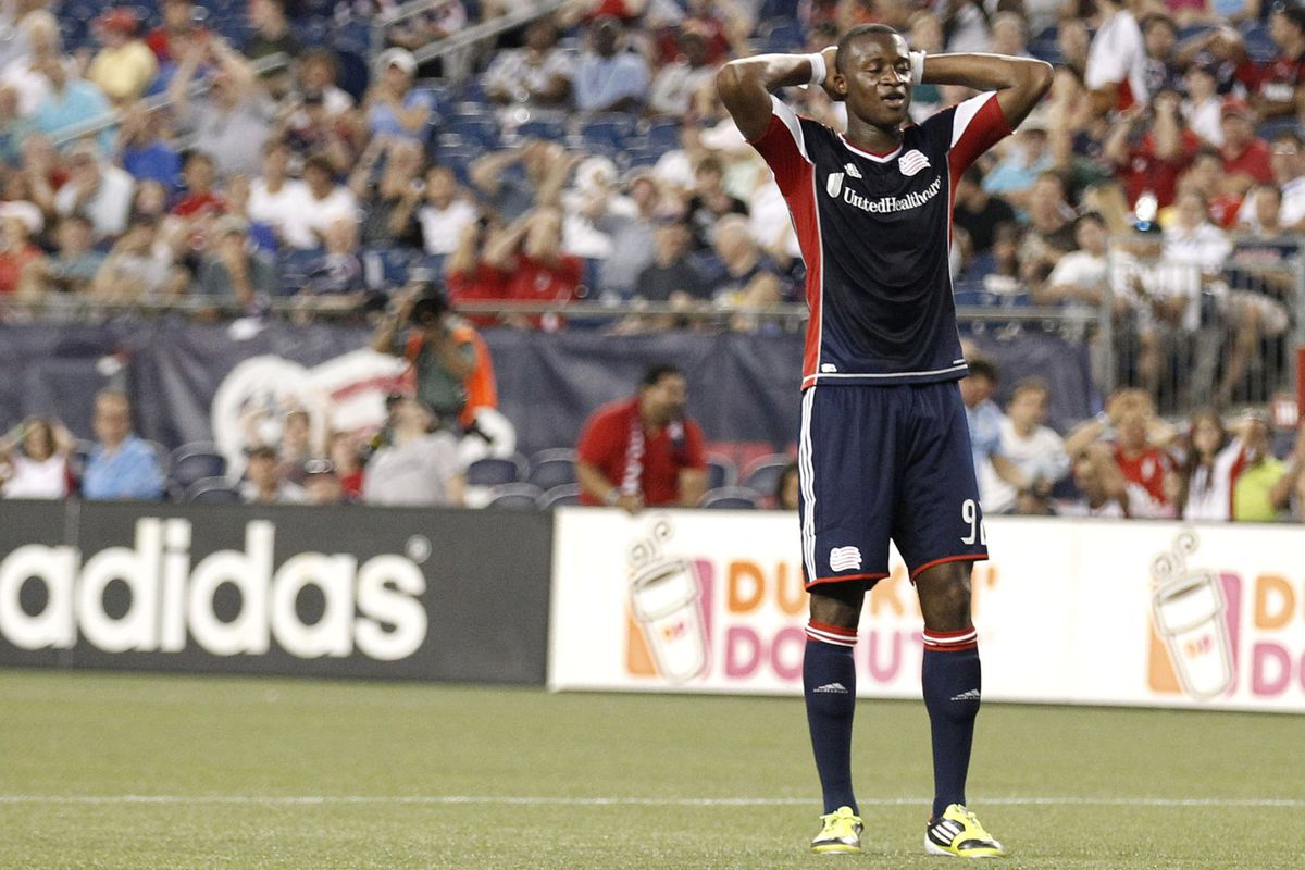 FOXBORO, MA - AUGUST 4:  Dimitry Imbongo #92 of New England Revolution reacts to missing a shot during the first half at Gillette Stadium on August 4, 2012 in Foxboro, Massachusetts.  (Photo by Winslow Townson/Getty Images)
