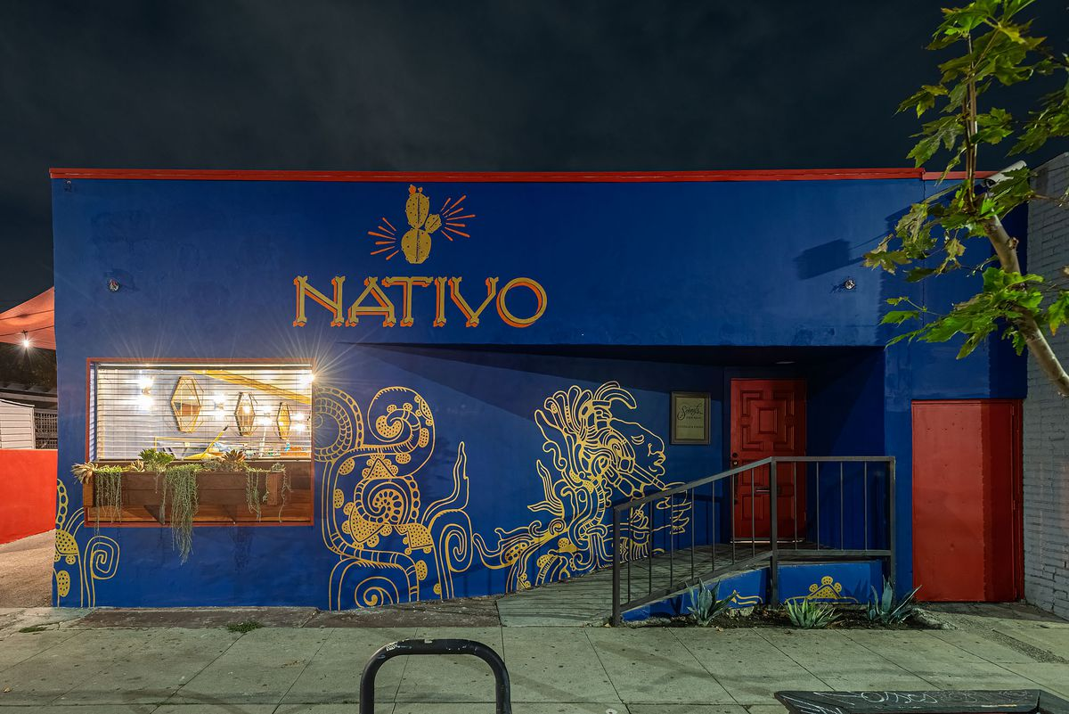 The dark blue exterior of a new restaurant called Nativo at night.