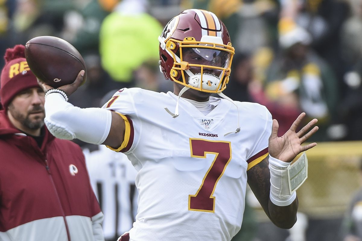 Washington Redskins quarterback Dwayne Haskins warms up prior to the game against the Green Bay Packers at Lambeau Field.