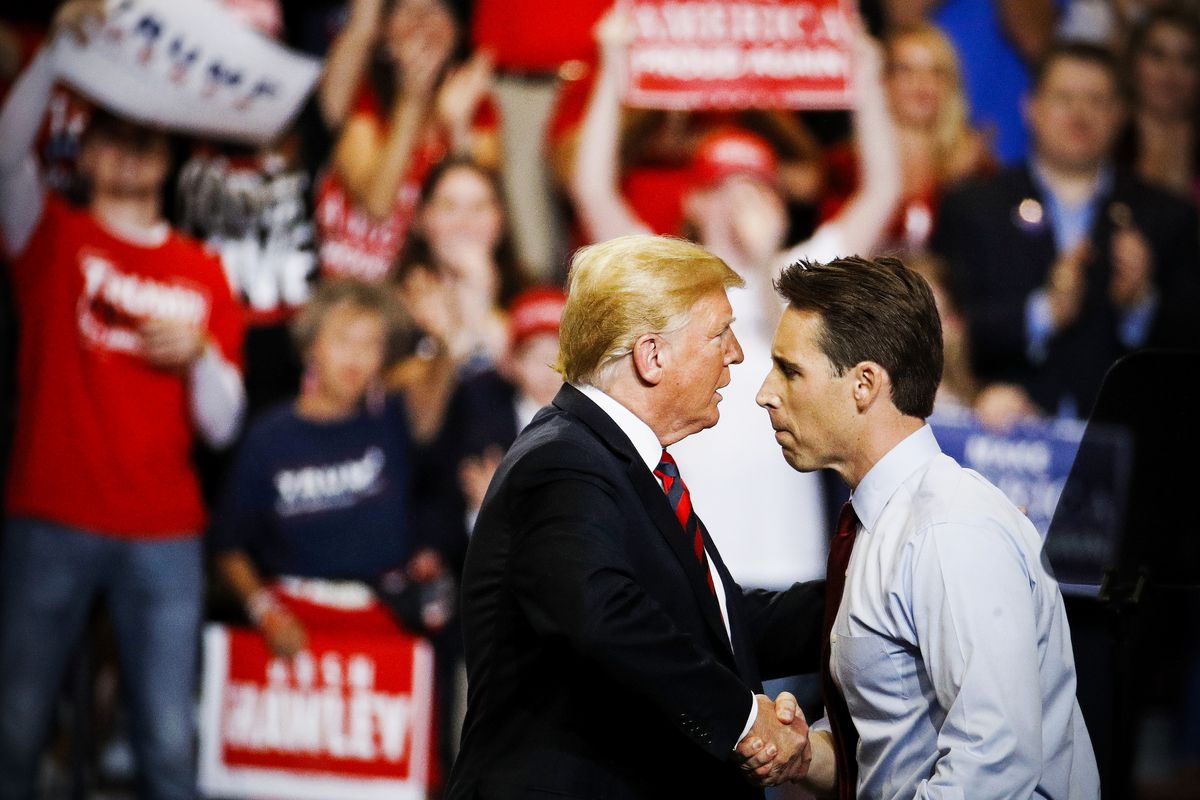 President Trump shakes hands with Senate candidate Josh Hawley during a campaign rally on Sept. 21, 2018, in Springfield, Mo.