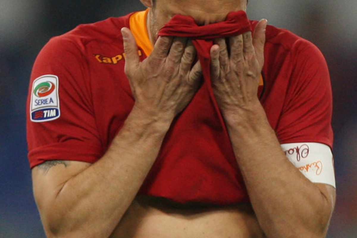 ROME, ITALY - MAY 05:  Francesco Totti of AS Roma shows his dejection after missing the penalty during the Serie A match between AS Roma and Catania Calcio at Stadio Olimpico on May 5, 2012 in Rome, Italy.  (Photo by Paolo Bruno/Getty Images)