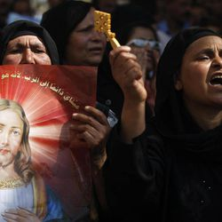 FILE - A Monday, May 9, 2011 file photo, Egyptian Coptic Christians chant angry slogans as they protest the recent attacks on Christians and churches, in front of the state television building in Cairo, Egypt. Egypt's estimated 8 million Coptic Christians are feeling increasingly cornered amid the rise to power of hardline Islamists after the ouster of Hosni Mubarak's longtime authoritarian regime and fear that they will bear the brunt of blame for the film that mocked the Prophet Muhammad.