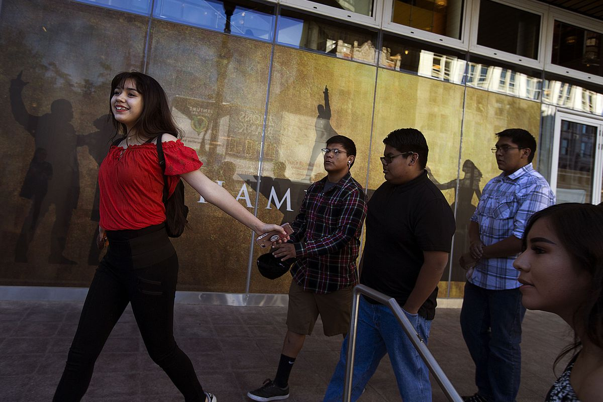 """Dachuneeh Martin runs to the door of the Eccles Theater in anticipation of seeing """"Hamilton"""" on May 4, 2018. """"Hamilton"""" returns to the Eccles Theater starting Dec. 28."""