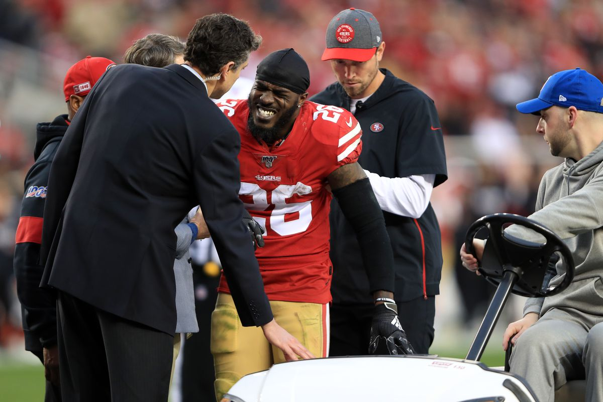 Tevin Coleman #26 of the San Francisco 49ers is carted off the field after an injury in the first half against the Green Bay Packers during the NFC Championship game at Levi's Stadium on January 19, 2020 in Santa Clara, California.
