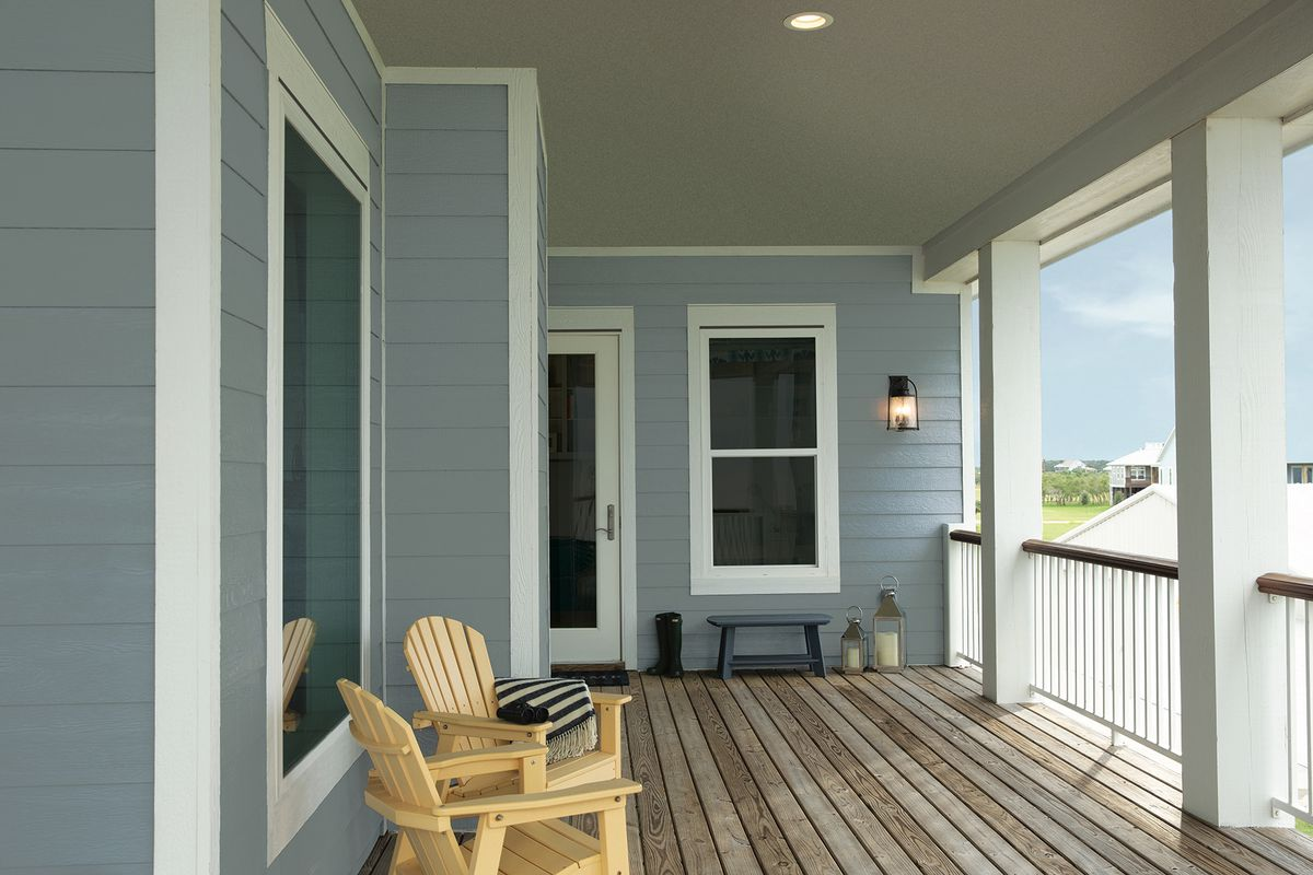Porch of home with blue-gray lap siding