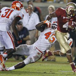 Florida State running back Chris Thompson (4) sheds Clemson linebacker Jonathan Willard (46) during the third quarter of an NCAA college football game on Saturday, Sept. 22, 2012, in Tallahassee, Fla. Florida State won 49-37.