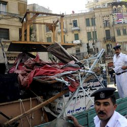 Egyptian police load furniture and other items confiscated from street vendors as they clear Tahrir Square in Cairo, Egypt, Saturday, Sept. 15, 2012 after days of protests near the U.S. embassy over a film insulting Prophet Muhammad.