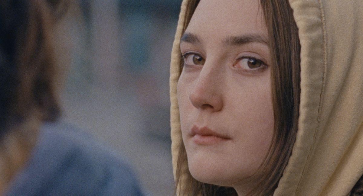 a girl wearing a hoodie