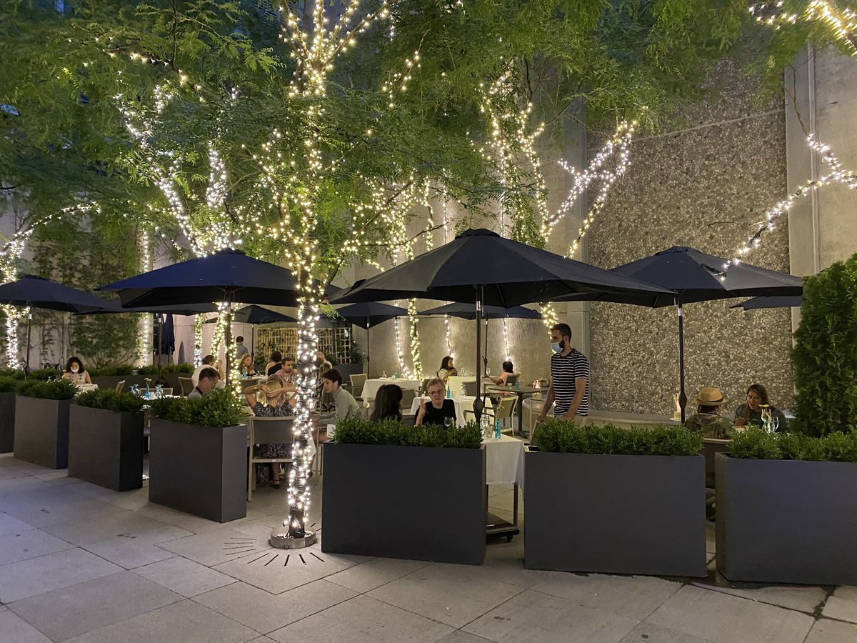 A restaurant's outdoor setup with fairy lights