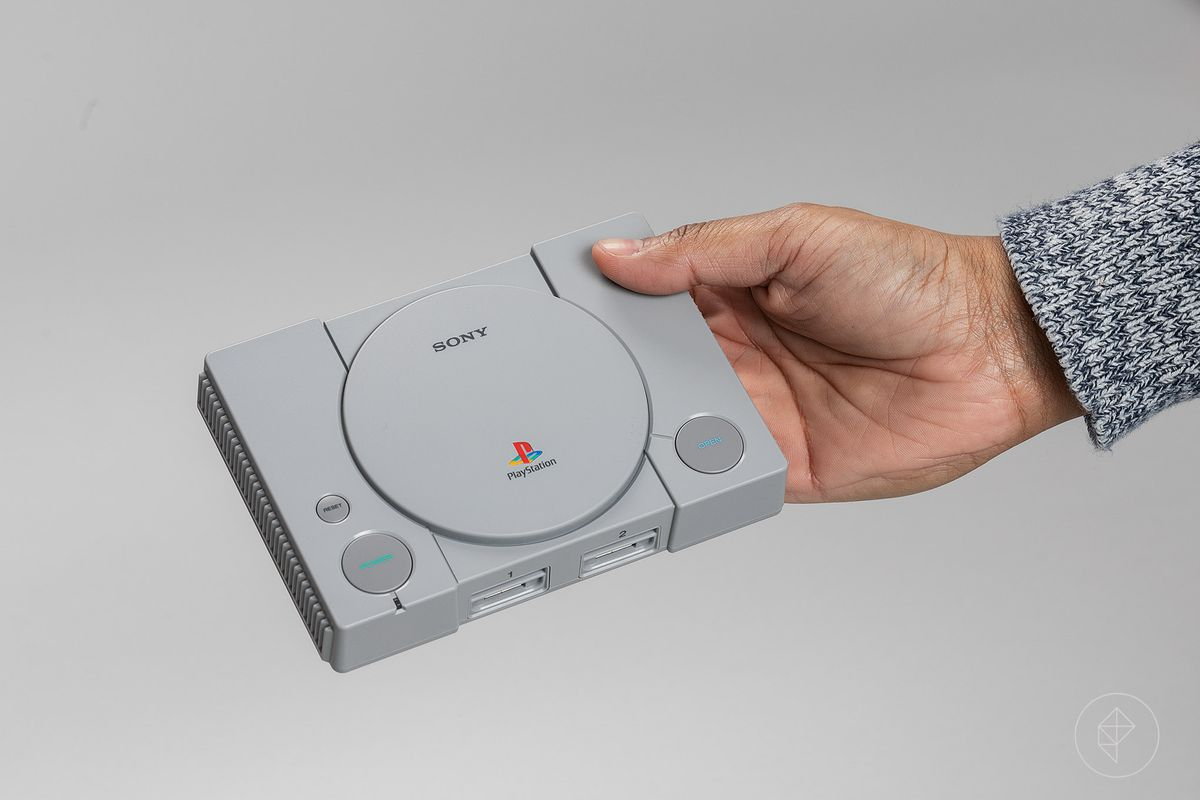 hand holding PlayStation Classic