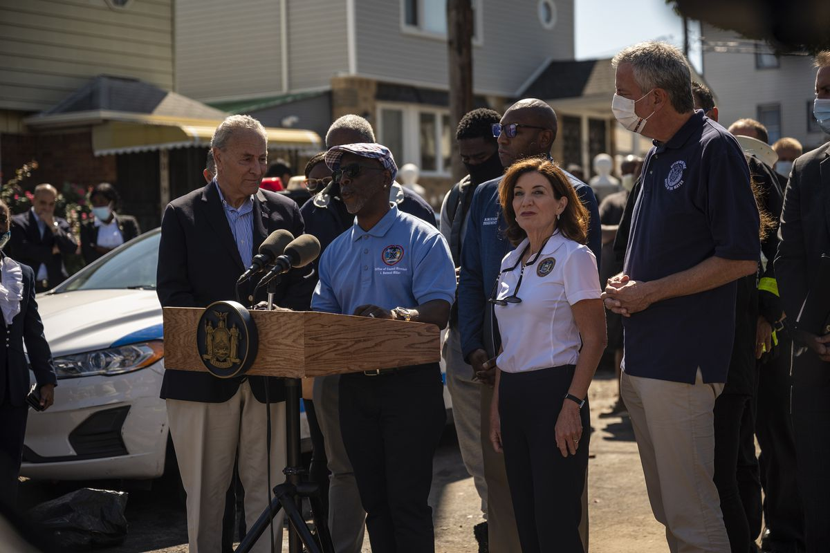 Elected officials, including Mayor Bill de Blasio and  Gov. Kathy Hochul, gather for a press conference at a hard-hit block in Hollis, Queens.