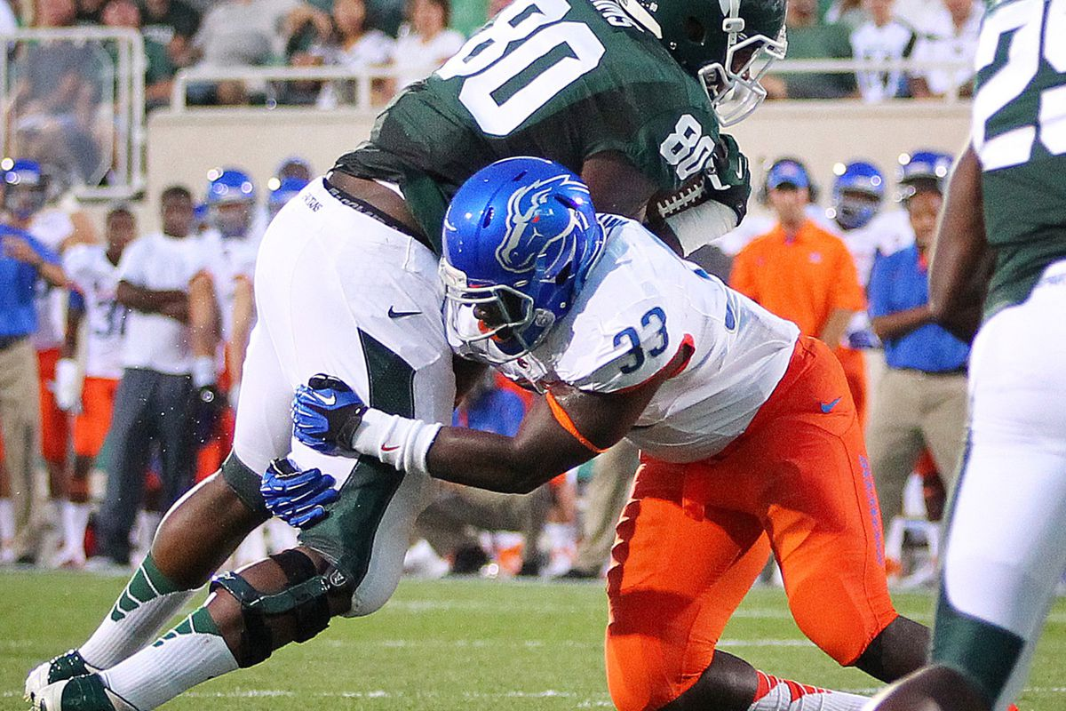 August 31, 2012; East Lansing, MI, USA; Boise State Broncos linebacker Tommy Smith (33) tackles Michigan State Spartans tight end Dion Sims (80) during the first quarter at Spartan Stadium.    Mandatory Credit: Mike Carter-US PRESSWIRE