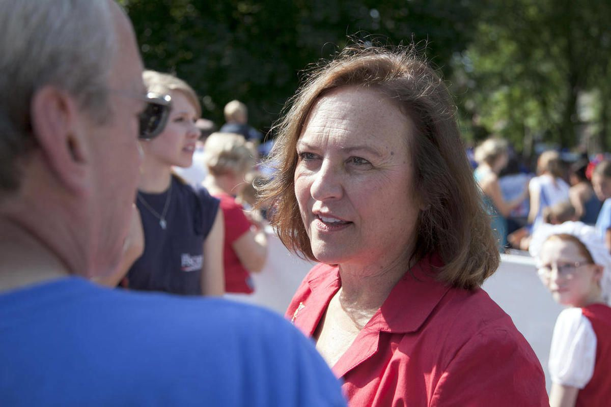 In this Wednesday, July 4, 2012 photo, Republican senate candidate, state Sen. Deb Fischer, center, campaigns at a July fourth parade in Omaha, Neb. Fischer is running against democrat Bob Kerrey for the senate seat vacated by Ben Nelson, D-Neb. Nebraska
