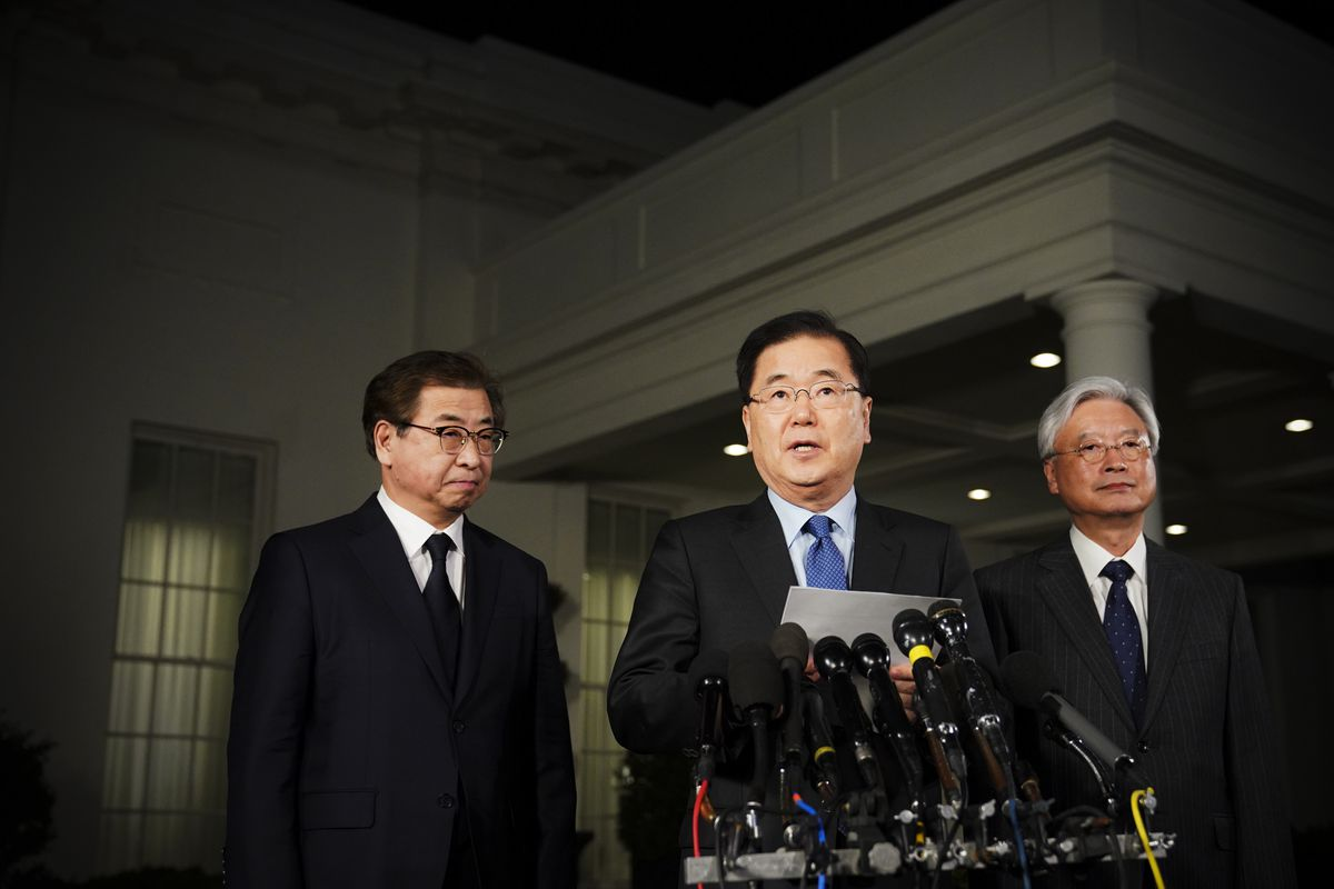 South Korean National Security Advisor Chung Eui-yong (center) briefs reporters outside the West Wing of the White House on March 8, 2018.