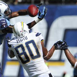 San Diego Chargers wide receiver Malcom Floyd (80) misses the catch as Tennessee Titans strong safety Robert Johnson, left, and cornerback Alterraun Verner, right, block the ball during the second quarter of an NFL football game on Sunday, Sept. 16, 2012, in San Diego. Verner picked up an interception on the play.