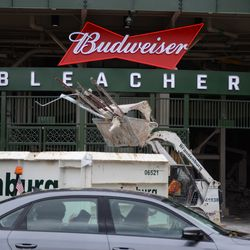 11:47 a.m. Debris being brought out through the bleacher gate -