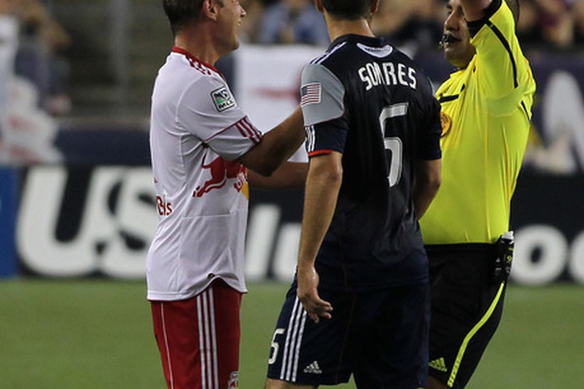 FOXBORO, MA - AUGUST 20: Teemu Tainio #2 of the New York Red Bulls is issued a red card during a game against the New England Revolution at Gillette Stadium on August 20, 2011 in Foxboro, Massachusetts. (Photo by Jim Rogash/Getty Images)