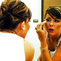 Jenni Henns puts the finishing touches on her makeup before taking the stage in the Miss Murray pageant.